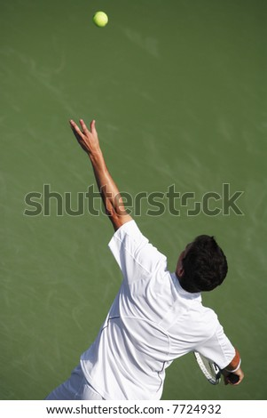 EDITORIAL USE ONLY.  High angle view of tennis player serving. - stock photo
