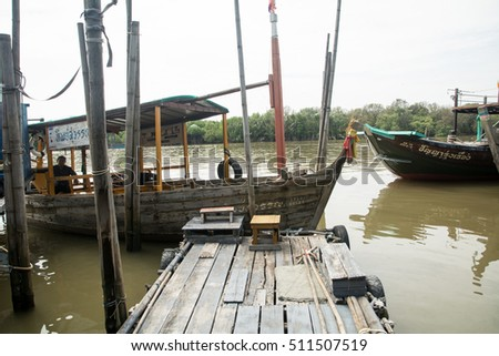 "Editorial use only: NOV 5,2016 : Docks For trips to see ""Irawadee"" dolphins at ""THAKAM"" district in Chachengsao Province east of Thailand,Fishing boats moored many boats here."