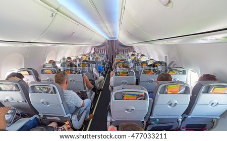 Editorial wide angle back view of passengers inside aircraft. Russia, 5 August, 2016.