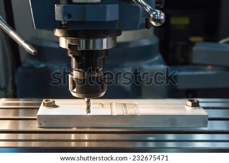 EDM machine working with coolant injection - stock photo