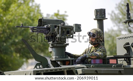 EDMONTON, AB, CANADA-July 18, 2014: A soldier in a Canadian Forces Armored Vehicle as seen in the K-Days Parade on July 18th, 2014.