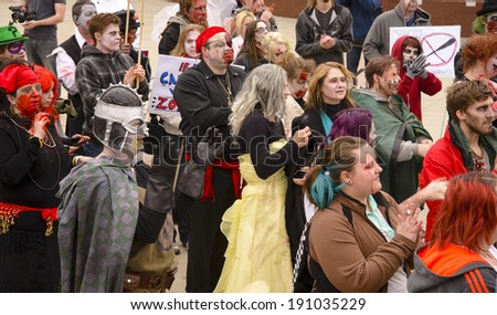 EDMONTON, AB CANADA - MAY 3, 2014: Unidentified bloodstained participants of the Zombie Walk in Edmonton, May 3, 2014.