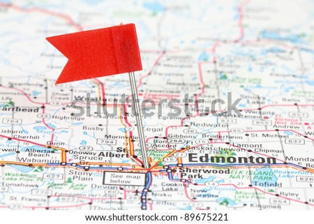 Edmonton in Alberta, Canada. Red flag pin on an old map showing travel destination. - stock photo