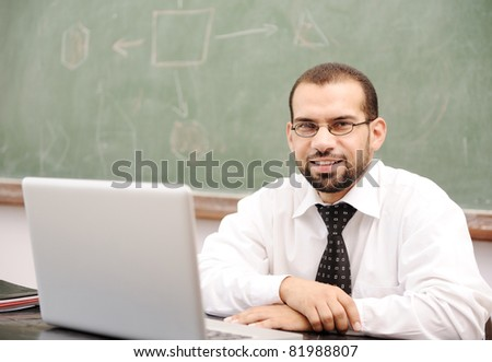 Education activities in classroom at school, Happy teacher with laptop - stock photo