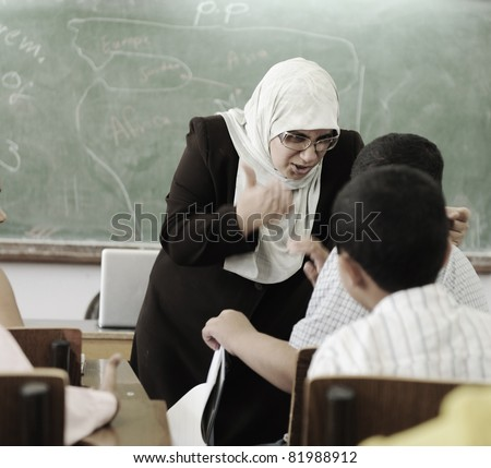 Education activities in classroom,  female teacher yelling at pupil - stock photo