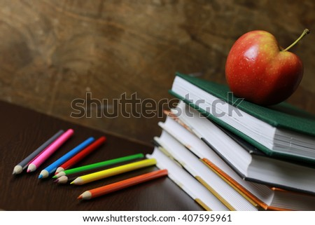 Education an apple and books - stock photo