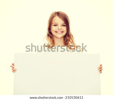 education and blank board concept - smiling little girl with blank white board - stock photo