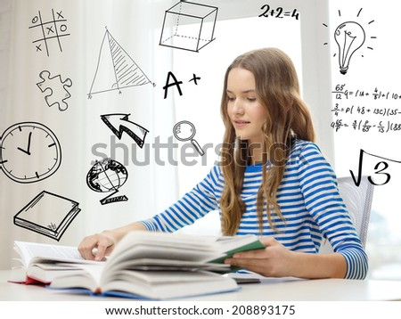 education and home concept - smiling student girl sitting at table and reading books - stock photo