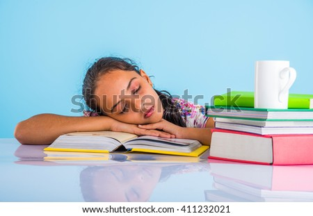 education and home concept - stressed student girl with books, indian girl child tired of studying or doing homework, asian girl studying and stressed - stock photo