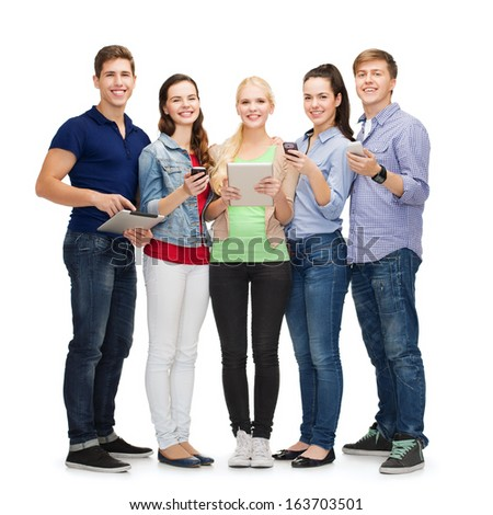 education and modern technology concept - smiling students using smartphones and tablet pc