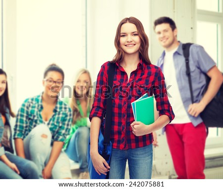 education and people concept - smiling female student with laptop bag and notebooks - stock photo