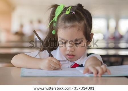 education and school concept homework is too much for little kids - stock photo