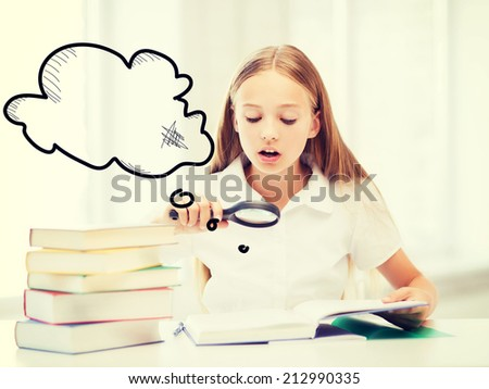 education and school concept - little student girl reading book with magnifier at school - stock photo