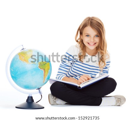 education and school concept - little student girl studying geography with globe and book - stock photo