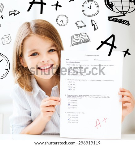 education and school concept - little student girl with test and A grade at school - stock photo