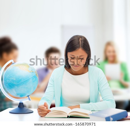 education and school, travel concept - female teacher with globe and book