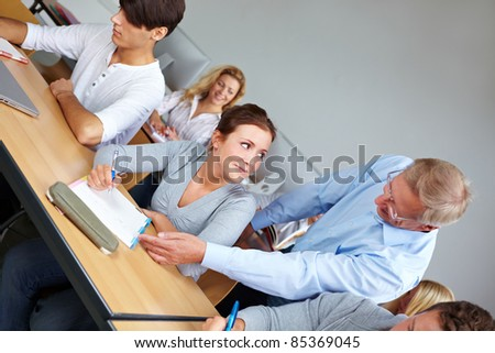 Education at University of Applied Sciences with teacher - stock photo