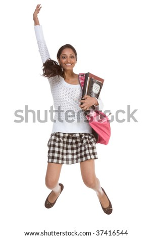 education back to school series - Friendly ethnic Indian woman high school student with backpack and composition book in checkered uniform skirt jumping in excitement
