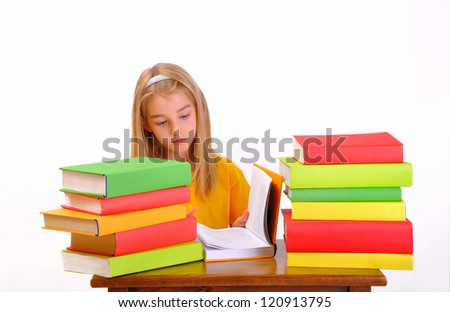Education - beautiful girl reading a book surrounded by books, isolated on white - stock photo