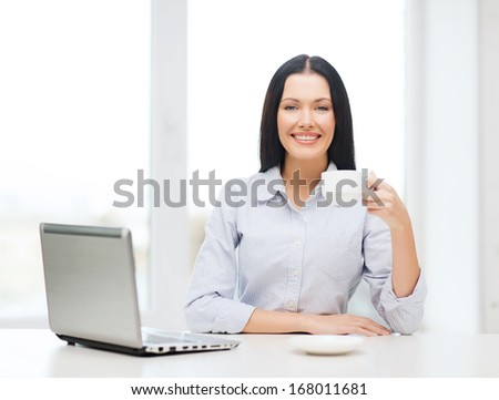 education, business and technology concept - smiling businesswoman or student with laptop computer and coffee