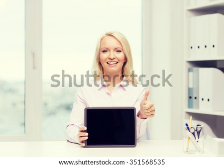 education, business, gesture and technology concept - smiling businesswoman or student showing thumbs up and tablet pc computer blank screen in office - stock photo
