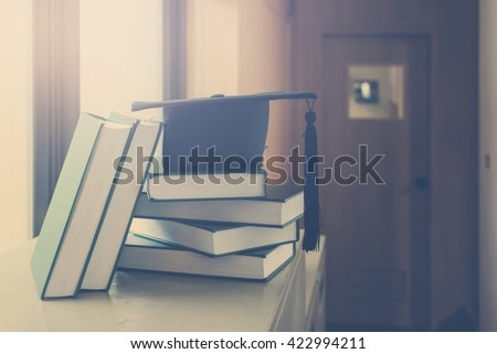 education cap and books,education concept,vintage tone - stock photo
