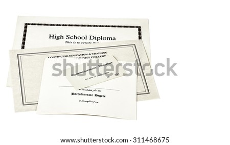 Education certification documents including high school diploma,commencement ticket, and continuing education certificate isolated on white