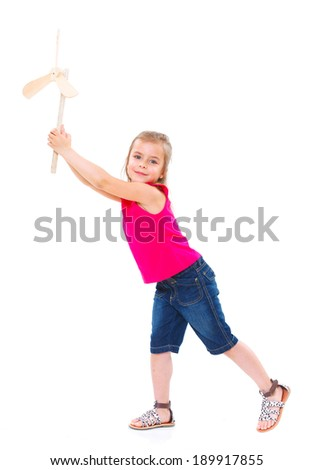 Education, childhood and ecology concept - smiling girl with wooden windmill toy. - stock photo