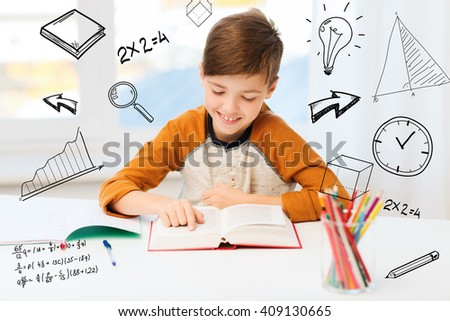 education, childhood, people, homework and school concept - happy student boy reading book or textbook at home over mathematical doodles - stock photo