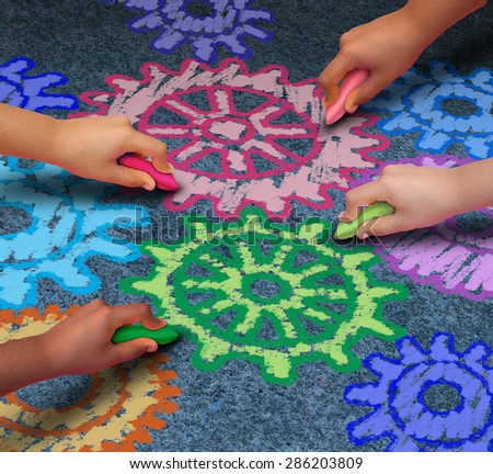Education concept as a diverse community of children working together in friendship drawing connected gears and cog wheels with chalk as a symbol for the success of learning with a school program. - stock photo