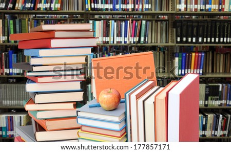 education concept: books in university library (blurred background)