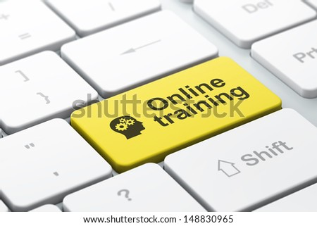 Education concept: computer keyboard with Head With Gears icon and word Online Training, selected focus on enter button, 3d render - stock photo