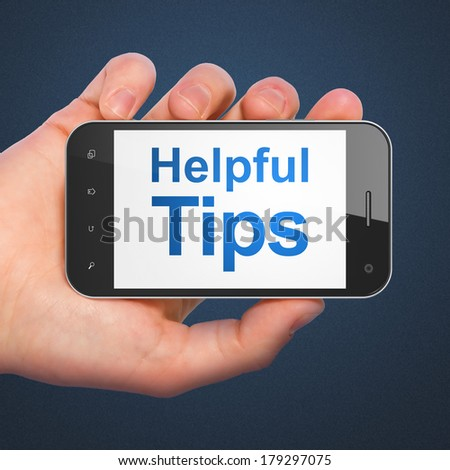 Education concept: hand holding smartphone with word Helpful Tips on display. Mobile smart phone on Blue background, 3d render - stock photo