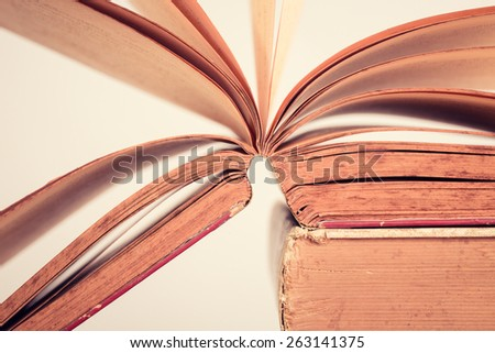 Education concept. Old books on table. Vintage filter - stock photo