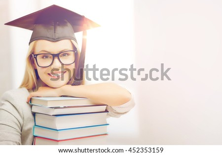 education concept - picture of happy student in graduation cap with stack of books - stock photo