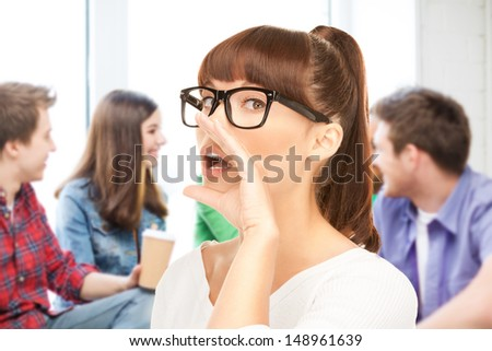 education concept - student girl gossiping at school