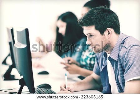 education concept - student with computer studying at school - stock photo