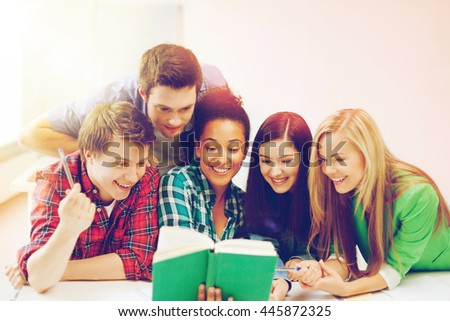 education concept - students reading book at school - stock photo