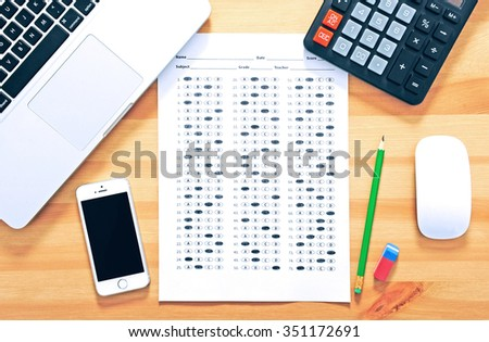 Education concept. Test sheet with answers - stock photo