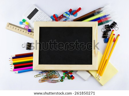 Education concept. Top view of blank blackboard with school and office supplies on white background - stock photo