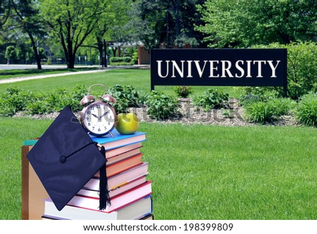 education concept with book and university campus - stock photo