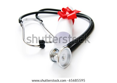 Education concept with diploma and stethoscope on white - stock photo
