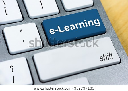 Education concept: Written word e-Learning on blue keyboard button. - stock photo