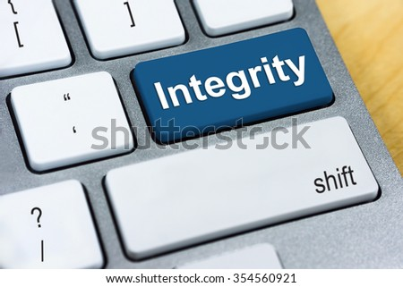 Education concept: Written word Integrity on blue keyboard button. - stock photo