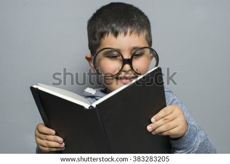 education, dark-haired young student reading a funny book, reading and learning
