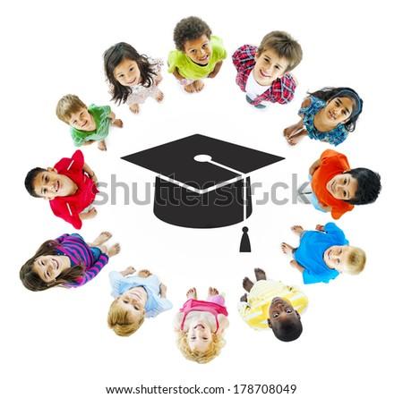 Education: Diverse Children Standing Around Mortarboard - stock photo