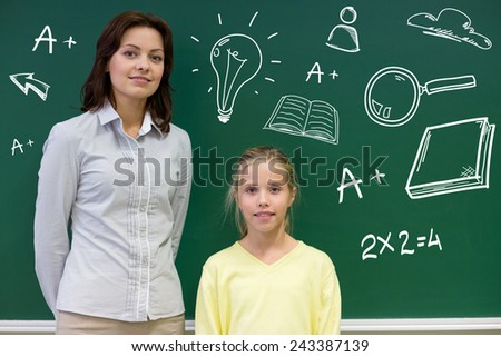 education, elementary school, learning and people concept - little school girl and teacher at green chalkboard with doodles in classroom - stock photo