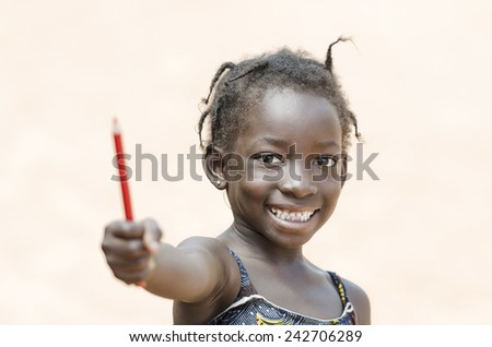 Education for Africa: Cute African Schoolgirl Showing Pencil - stock photo