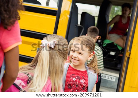 Education: Friends Talking While Boarding School Bus - stock photo