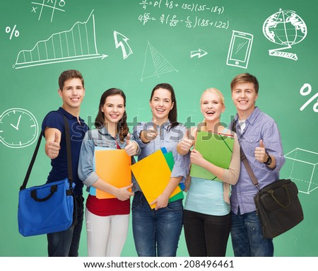 education, friendship and people concept - group of smiling students with folders and bags showing thumbs up over green board - stock photo